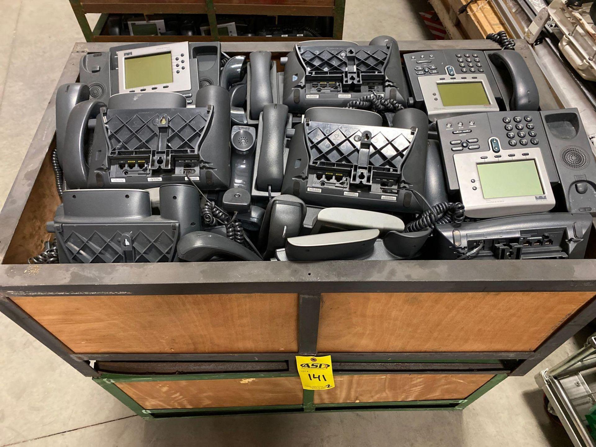 Lot 141 - TWO CRATES OF CISCO IP PHONES
