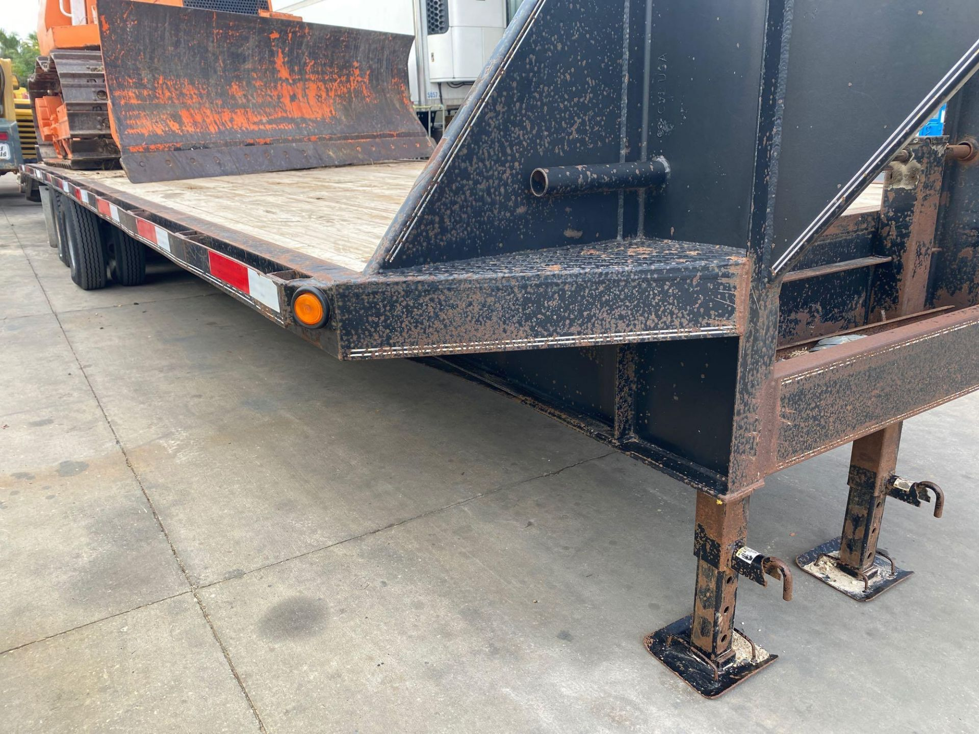 Lot 35 - 2011 32' TEXAS BRAGG TRAILER, GOOSE NECK, NEW DECK, FOLD DOWN RAMPS,