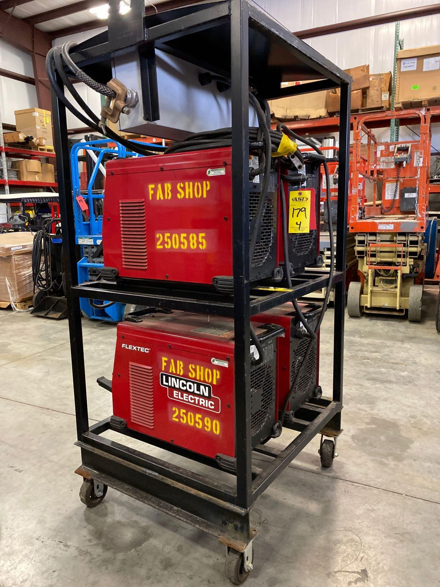 Lot 179 - FOUR LINCOLN ELECTRIC FLEXTEC 450 WELDERS ON CART
