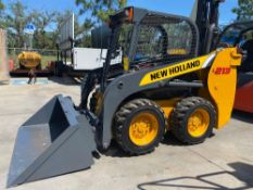 2011 NEW HOLLAND SKID STEER, APPROX. 3,800 HOURS SHOWING, BUCKET ATTACHMENT, RUNS AND OPERATES