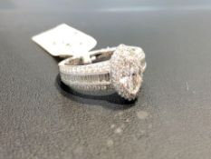 1.61CT TOTAL DIAMOND RING, CENTER .71CT MARQUIS, .47CT ROUND AND .43CT BAGUETTE CUT SIDE DIAMONDS, 1