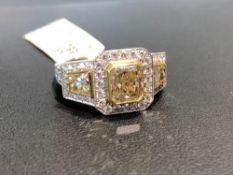 CUSTOM 1.48CT RADIANT YELLOW CENTER DIAMOND, .88CT TOTA FANCY YELLOW TRAPEZOID SIDE DIAMONDS, .77CT
