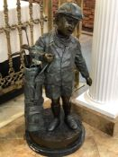 """BOY GOLFER WITH BAG AND CLUBS BRONZE. APPROX 42"""" TALL X 19"""" BASE DIAMETER"""