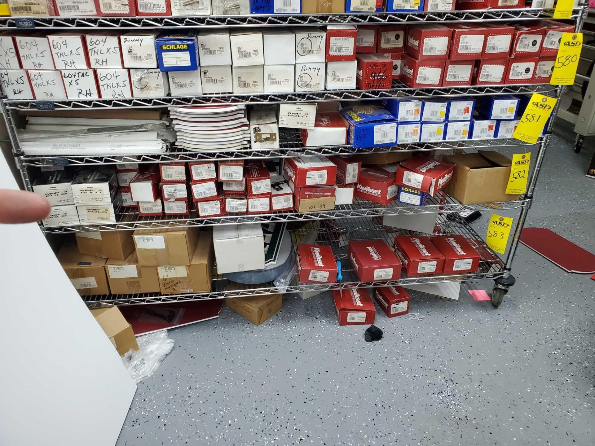 SHELF LOT OF KWIKSET SCHLAGE ETC APPROX 120 BOXES