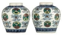 PREMIUM LOT - Full registration and deposit are required before bidding. A fine pair of doucai chrys  PREMIUM LOT - Full registration and deposit are required before bidding.A fine pair of doucai chrysanthemum 'roundels' jars, seal marks and period of Daoguang, H 13,5 cmSimilar pair sold at Sotheby's Hong Kong (8 April 2011 lot 3170)