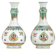 A pair of famille verte bottle vases