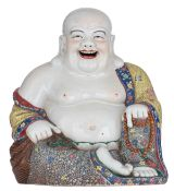 A large Chinese famille rose seated smiling Budai