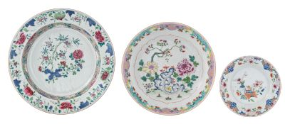 Two Chinese floral decorated famille rose chargers; added a ditto dish