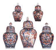 A collection of five Japanese Imari vases and covers