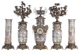 A Chinese Canton famille rose five piece mantle clock garniture