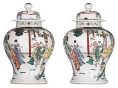 Two Chinese polychrome vases and covers