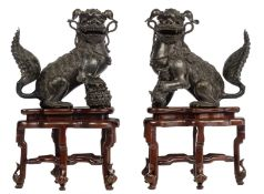 A pair of Japanese bronze playful Shishi dogs