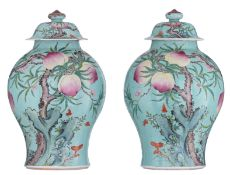 A pair of turquoise ground covered vases