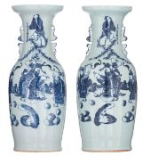 A pair of Chinese celadon ground blue and white vases