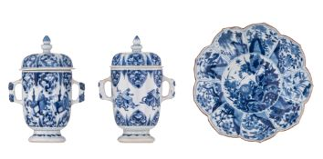 Two Chinese Kangxi period blue and white chalices with covers