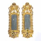 A pair of antique mirrors