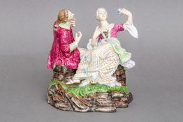 Porzellanfigur ¨Rokoko-Paar mit Blüten auf Natursockel¨