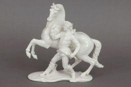 NYMPHENBURG Porzellanfigur ¨Reiter, Pferd vorführend¨