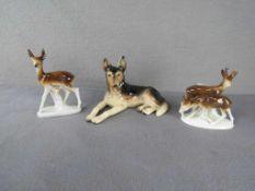 Drei Porzellanfiguren Rehe und Schäferhund<