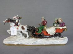 Porzellanskulptur Russische Schlittenfahrt farblich staffiert unterseits gemarkt Länge:40cm