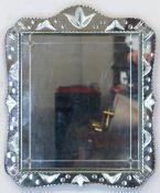 Spiegel, im venetianischem Stil, geschweifter geschliffener Rand, 47x39 cm