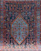 Teppich, blau-/rotgrundig, mit zentralem Medaillon u. floralen Motiven, alle Kantenbelaufen, 2