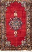 Teppich, Persien, rot-/ blaugrundig, mit zentralem Medaillon und floralen Motiven, guterZustand,