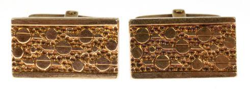 Paar Manschettenknöpfe, 585er GG, zus. ca. 12,3 g, rechteckig mit Reliefdekor, 2,2x1,2 cm