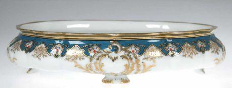 Schale, Fürstenberg, ovaler Korpus auf 4 Füßen, floraler Dekor, türkisfarbener Rand mit reicher
