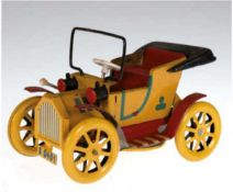 Modellauto, Blech, rot/gelb lackiert, Gebrauchspuren, L. 14,5 cm