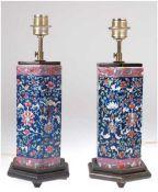 Paar Tischlampen, Porzellan, 1-flammig, 6-eckiger Stand, mit polychromer Blumenmalerei, H.46