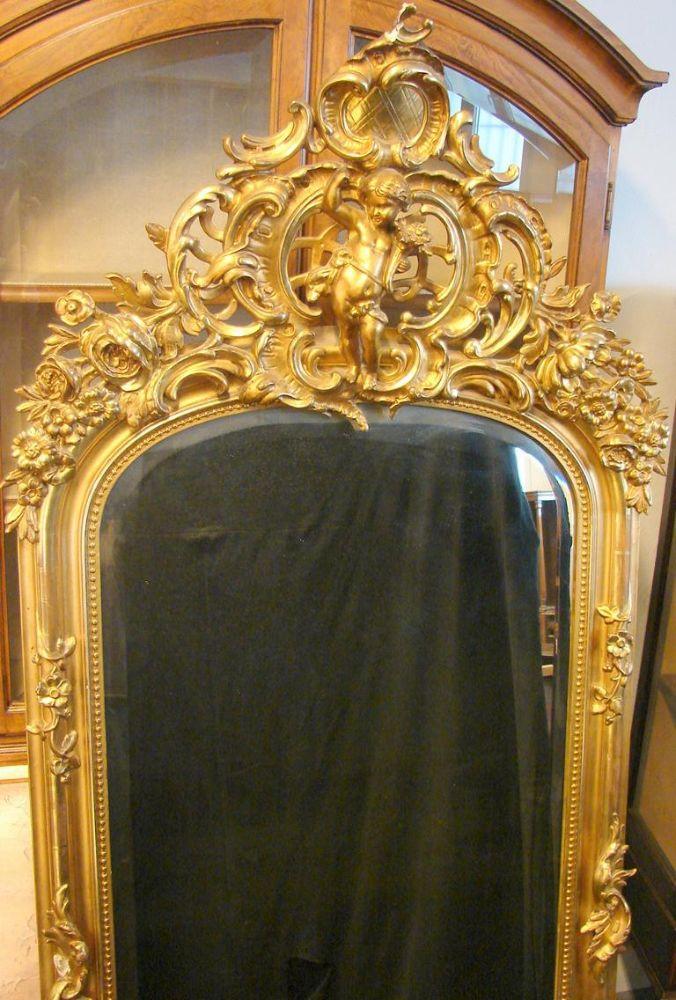 Spiegel, aufwendig gearbeiteter Aufsatz mit Puttendarstellung, Holz,Höhe ca. 195, B. 83 cm