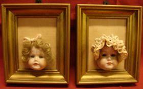 Paar Rahmen mit Puppenköpfen, ca. 11,5 x 9,5 cm
