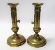 2 Biedermeier Schiebeleuchter, um 1830/40, Messing, h 17,5 cm, d 9,5 cm.
