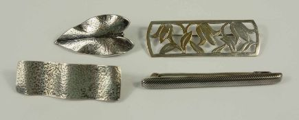 3 brooches and a dress clip, silver, weight 15,19g, different shapes, l. from 4cm to 6,3cm