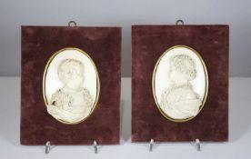 Paar Elfenbein Reliefs, Kinderportraits, plastisch geschnitzt, auf mit Samt bezogenem Rahmen