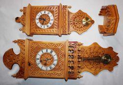 2 Wanduhren z.T. bez. SELVA dat. 1991, Holz beschnitzt