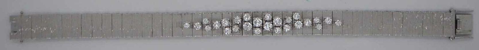 1 Damenarmband WG 18ct., Brill.L ca. 16,3cm, mit Zusatzstück zum Verlängern, mit Zer