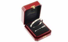Cartier Love Armreif 18K WG, Innenumfang: 14,00 cm, mit Schraubenzieher und Etui, Total 32,12 g.