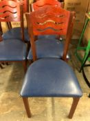 Metal frame chair with wood back and padded seat