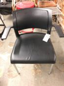 Black padded arm chair