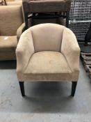 Curved back upholstered armchair
