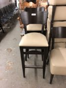 Curved back wood chair and stool with padded seat