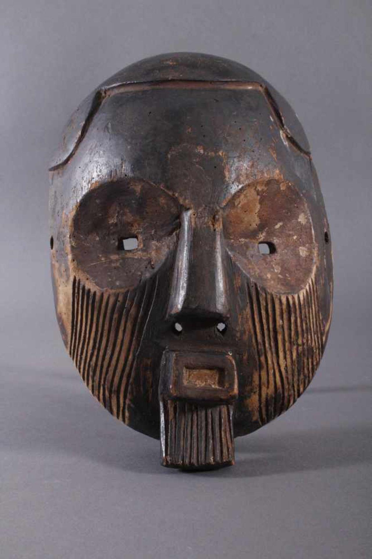 Antike Maske, Zaire/Kongo 1. Hälfte 20. Jh.Holz geschnitzt, dunköe Patina . Gesicht mit linearen