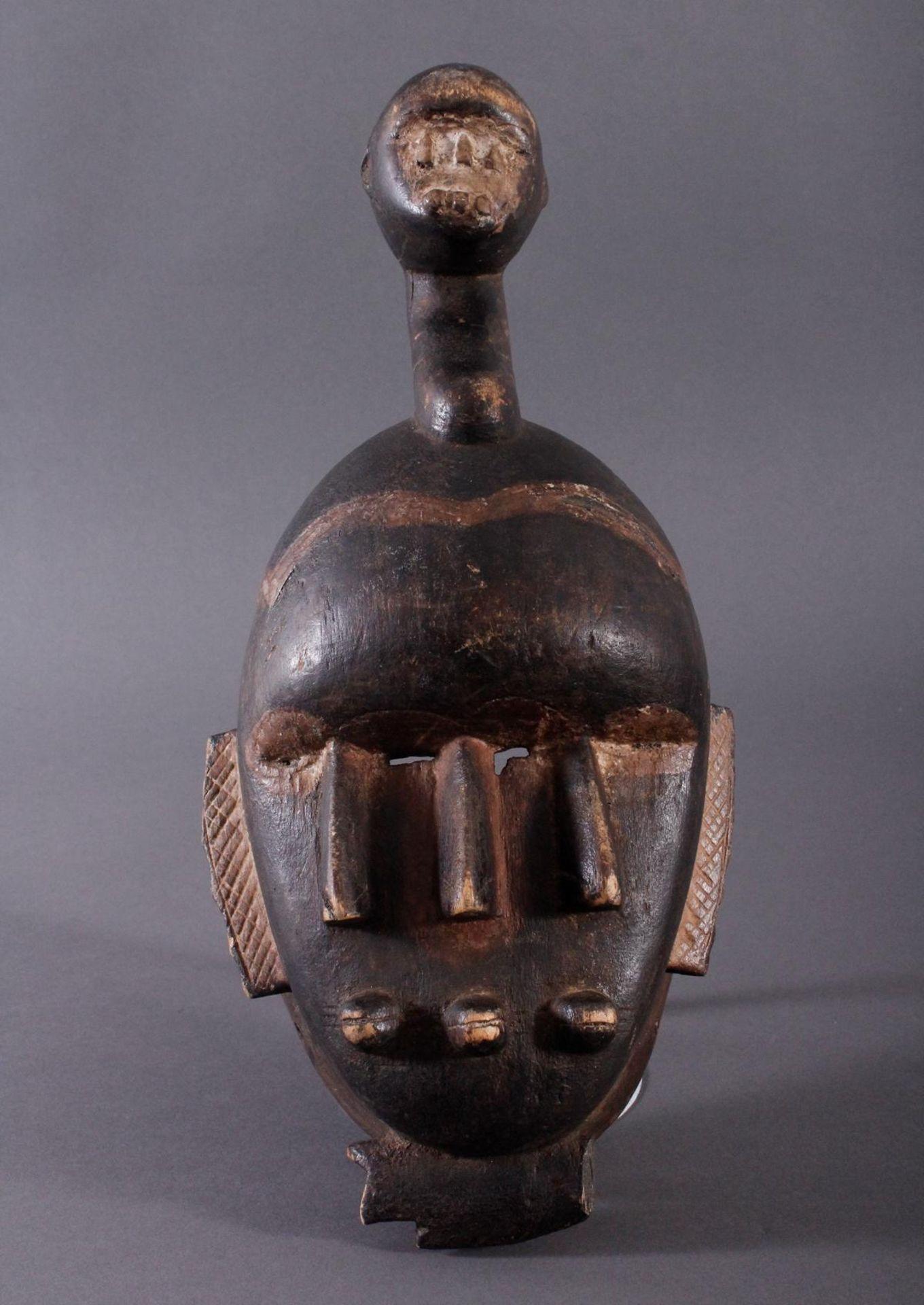 Antike Kpelie-Maske, Senufo 1. Hälfte 20. Jh.Holz geschnitzt, geschwärztes, leicht glänzendes,