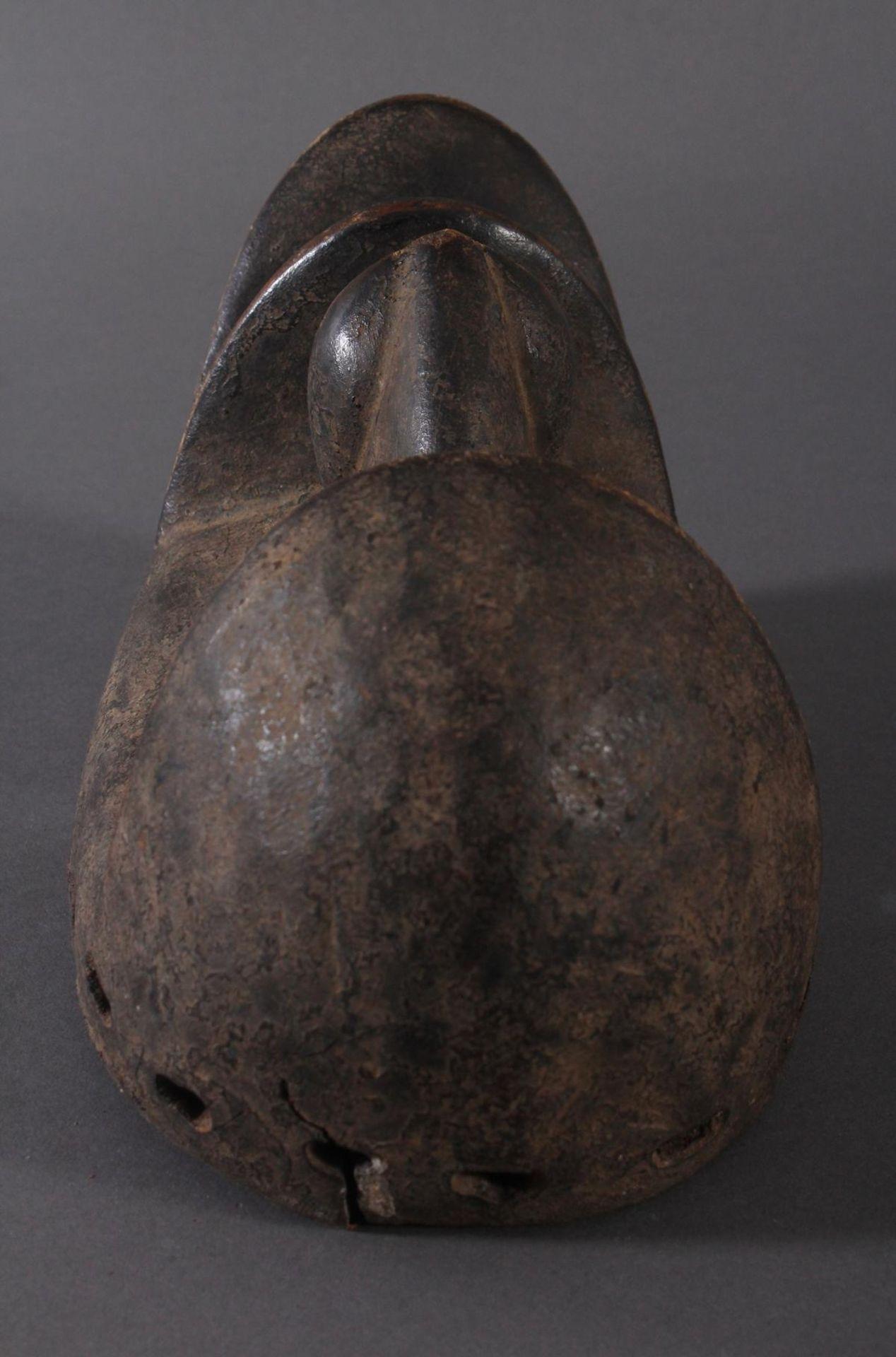 Antike Maske der Dan-Kran, Elfenbeinküste 1. Hälfte 20. Jh.Holz geschnitzt, dunkle Patina ,nach - Bild 6 aus 6