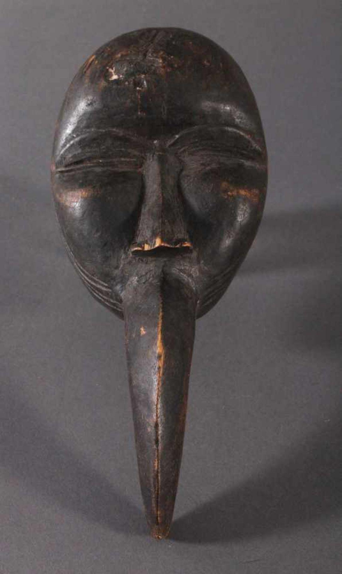 Antike Maske, Dan, Liberia 1. Hälfte 20. Jh.Holz geschnitzt, dunkle Patina, Schnabelmaske, ca. 6 x