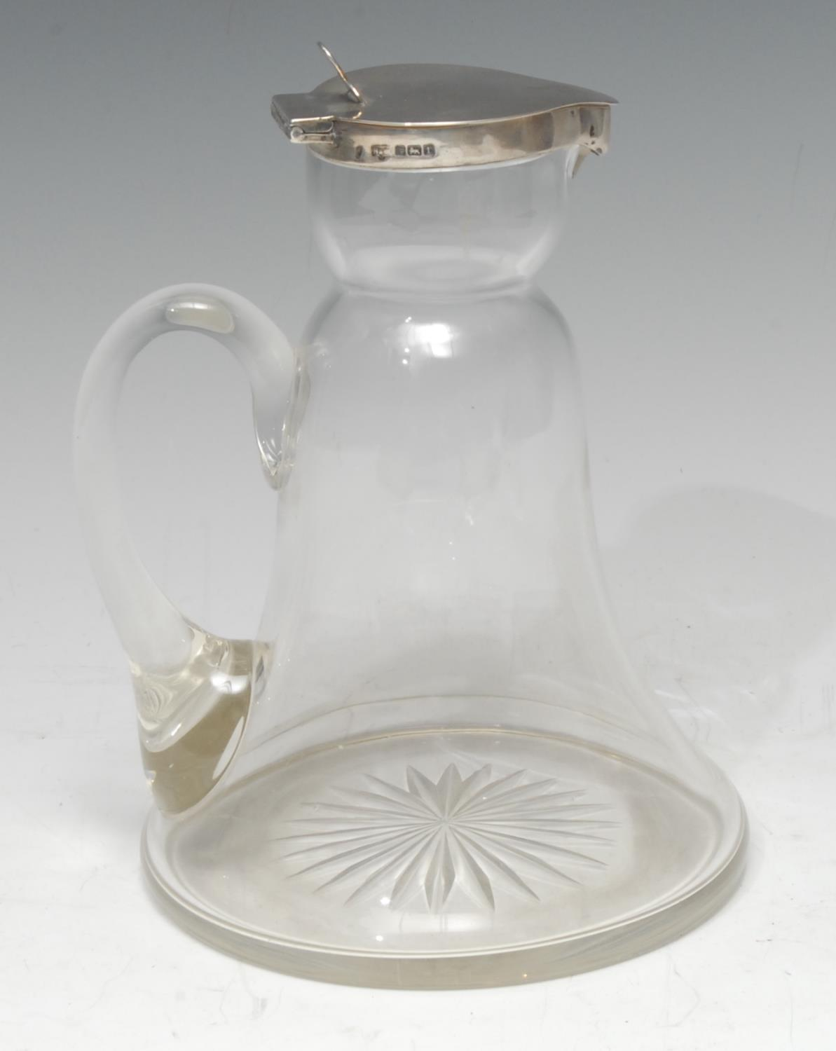 An unusually large Edwardian clear glass whisky noggin, flat hinged cover, 10.