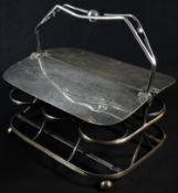 An unusual Victorian E.P.N.S milk bottle waiter, the hinged twin covers engraved 'Milk From Own