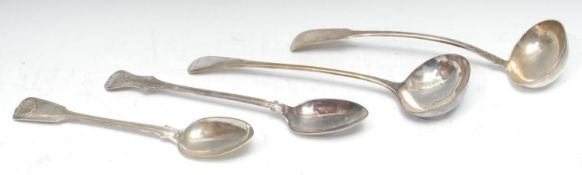 A Victorian silver Shell and Fiddle pattern serving spoon, George Angell, London 1848; another,